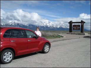 Picture of Pat and our rental car.