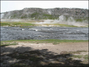 Picture of the Old Faithful Geyser Basin area and Firehole River.
